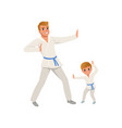 smiling father and son training karate blows dad vector image vector image