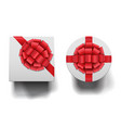 closed round and square boxes whit big bows set vector image