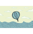 Hot air balloon over the sea vector image