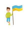 boy holding national flag of ukraine design vector image vector image