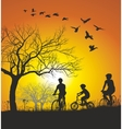 Family cycling in the countryside at sunset vector image