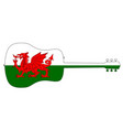 acoustic guitar silhouette with welsh national vector image vector image