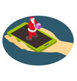 santa claus from a smartphone gives a gift vector image