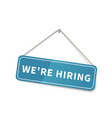 bright glossy we are hiring sign hanging on the vector image