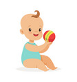 adorable smiling baby sitting and playing with a vector image vector image