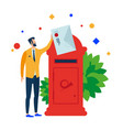 the man puts the letter in the mailbox vector image