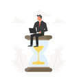 businessman with laptop sits on a big hourglass vector image vector image