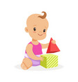 sweet smiling baby sitting and playing with toy vector image vector image
