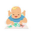 cute happy baby boy painting by hands colorful vector image vector image