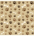 pattern with brown footprints and bones vector image