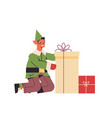 green elf guy holding gift box male santa helper vector image vector image