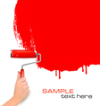 hand with red roller painting vector image vector image