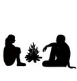 silhouette a man and woman sitting fire vector image vector image