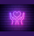 hands holding heart neon sign medicine and health vector image vector image
