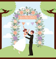 celebrating couple wedding in park arch flowers vector image