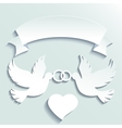 Doves holding wedding rings vector image vector image