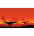 Silhouette of mapusaurus orange sky scenery vector image vector image