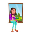 sad girl sitting on the window isolated vector image