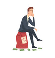 successful rich businessman sitting on big heavy vector image vector image