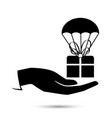 package flying down with parachute vector image