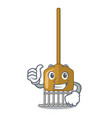 thumbs up cartoon rake leaves with wooden stick vector image