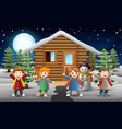 cartoon kids singing in front of the snowing house vector image vector image