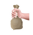 hand holding a small sack vector image