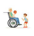 boy playing ball with grandmother sitting in a vector image vector image