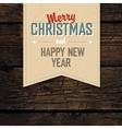 christmas tag vintage on hardwood planks vector image vector image