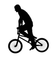 Black silhouette of a young man on a bike vector image vector image