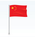 flag of china waving on a metallic pole vector image vector image