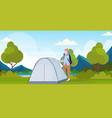 woman hiker camper installing a tent preparing for vector image vector image