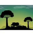 Silhouette rhino in the field vector image