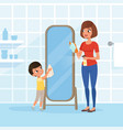 smiling little boy helping his mother at housework vector image vector image