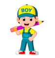 cute boy holding big pencil vector image vector image
