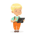 smiling little boy using digital tablet for vector image vector image
