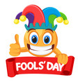 smiley face in a jester hat smiles widely vector image vector image