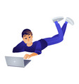 cartoon boy lying at floor near laptop vector image vector image