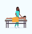 young girl having back massage african american vector image vector image