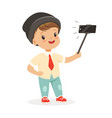 cute little boy in fashionable clothes taking vector image vector image