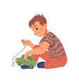 kindergarten child playing with car toy active boy vector image