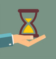 hand holding hourglass time is money concept vector image vector image