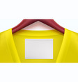 yellow clothes and empty tag on the collar wooden vector image