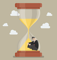 Businessman stuck in sandglass vector image vector image