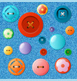 set of multicolored buttons on a jeans background vector image vector image