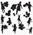 child holding balloons silhouettes vector image vector image