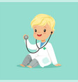 cheerful toddler boy in white medical gown playing vector image vector image
