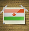 Flags Niger at frame on a brick background frame vector image