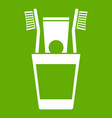 plastic cup with brushes icon green vector image vector image