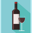 red wine bottle and wine glass on blue background vector image vector image